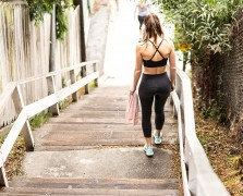 Back of woman in workout outfit going down Santa Monica stairs