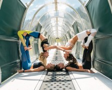 Four women doing yoga in a tunnel