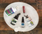 Aerial view of a white marble plate on a wooden table with a variety of holistic supplements
