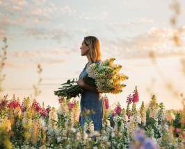 floret farm founder in field of flowers