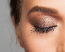 Close up of a closed woman's eye wearing makeup, including non-toxic mascara