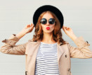 girl with striped shirt black hat and red lipstick