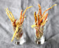 Close-up shot of long stems of dehydrated carrot chips in two glasses