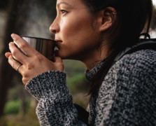 girl sipping hot tea out of a mug