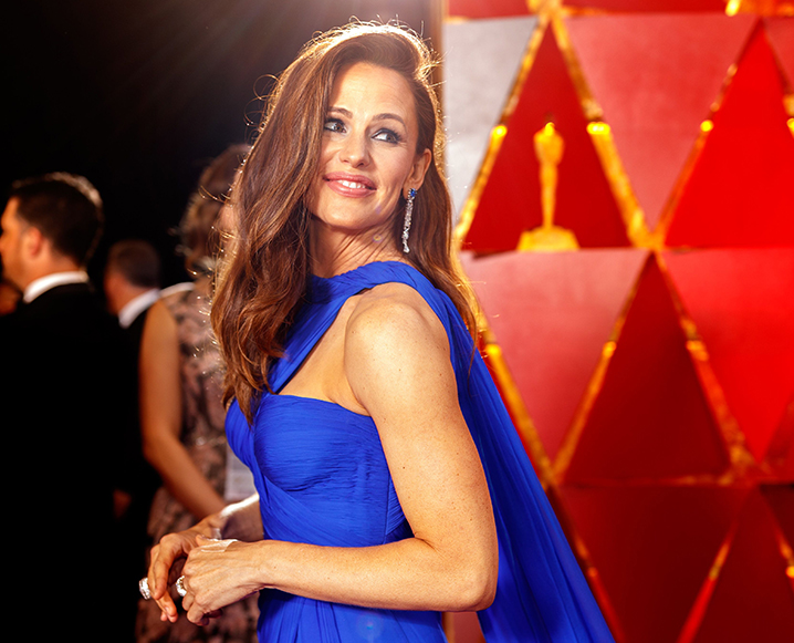 Jennifer Garner on the red carpet at the Oscars, wearing a blue gown